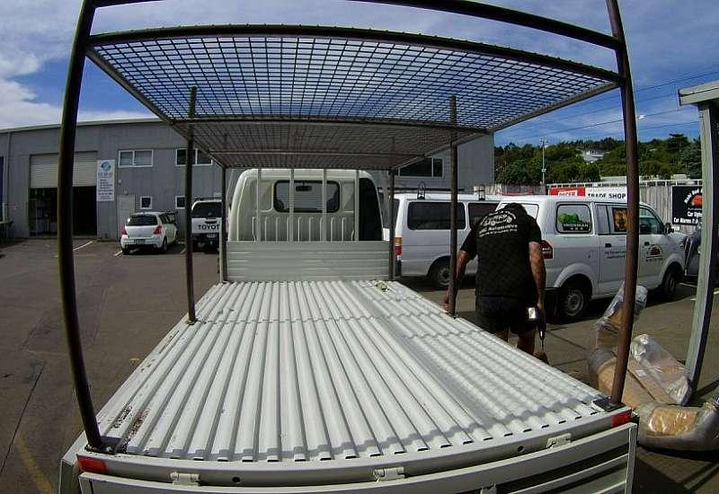 Ladder rack for light truck